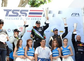 Chonsawat Asavahame (rear-center) holds up the champion's trophy after winning Round 4 of the Thailand Super Series Class 1 at the Bira International Race Circuit in Pattaya, Sunday, August 18.