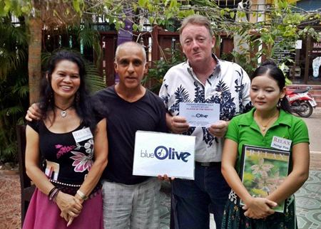 Mukesh Thakkar (2nd left) presents the Blue Olive monthly award to John Bartley (2nd right).