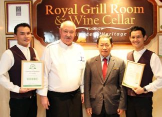Royal Cliff Hotels Group Executive Chef Walter Thenisch (second left), Food & Beverage Director Paitoon Ritdej (second right), Restaurant Manager Vichai Pooalai (right), and Assistant Restaurant Manager Vinyoo Rosdee (left) proudly display their award.