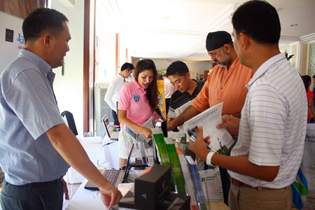 Pattaya's tourism professionals browse the new technology on display.