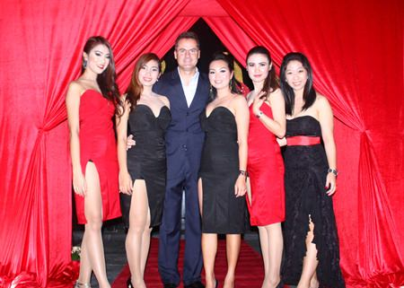 Richard Margo, Mantra's resident manager (center) poses with ladies suitably attired for an evening of Latin music and dancing.