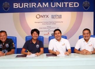 Newin Chidchob (left) poses with representatives of Buriram United Football Club and ONYX Hospitality Group at a press conference to announce the new football themed hotel.