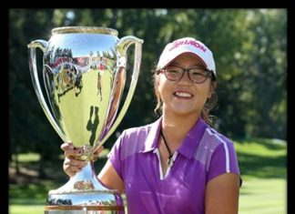Lydia Ko of New Zealand poses with the champion's trophy after winning the LPGA Canadian Women's Open golf tournament in Edmonton, Alberta, Sunday, Aug. 25, 2013.