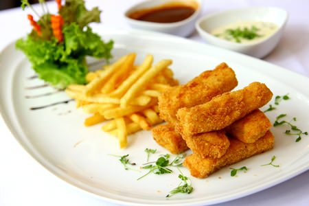 Breaded fish fillet with French fries at Cascade.