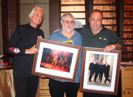 (L to R) Jimmy Page with Phil Chester & Terry Hermansen and their winning items.