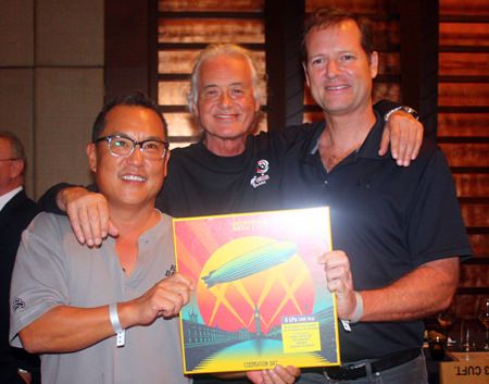 (L to R) John Bahng, Jimmy Page and Roger Cross with his signed Led Zeppelin Celebration Day vinyl box set.