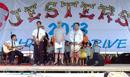 Representatives from The Regent's International School sing the national anthem before opening Jesters Care for Kids 2013 Charity Fair.