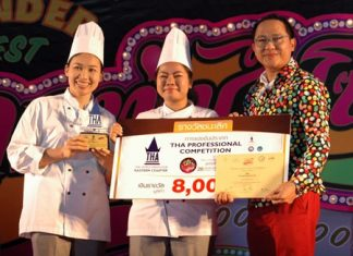 Juttaporn Daosawa and Suphat Kanongphat from the Dusit Thani Pattaya accept the winning award in the 'Wedding Cocktail /Canapé & Fruit Carving' competition from Attapol Wannakij, director of TAT Pattaya Office.