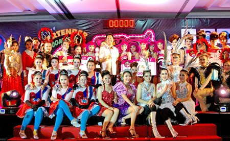 Participants from the 10 teams in 'Miss Pattaya Bartender' event pose on stage with Pattaya city mayor, Ittipol Kunplome.