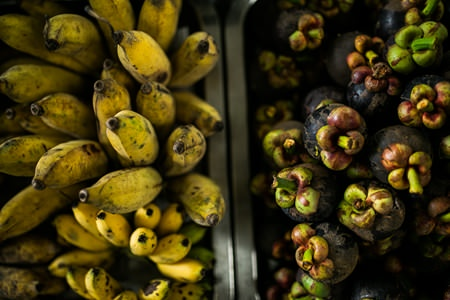 Bananas are available all year round, while mangosteens are in season from May to October.
