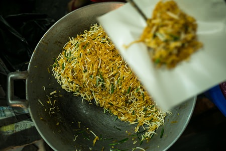 A pushcart stall serves up the popular dish of Pad Thai.