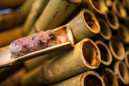 Khao Lam, a dessert made of sweet sticky rice stuffed in bamboo.