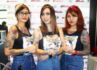 Sweet painted ladies show off their beautiful tattoos at the 3rd Pattaya International Tattoo Convention.