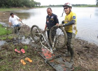 Wolf Minderjahn thanks rescue workers for pulling him and his bike out of the mud where they had been stuck for 3 hours.