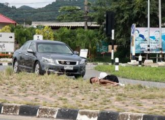 Police were able to wake up and chase off this homeless man before he rolled out into traffic in his sleep.
