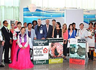 IUHPE President Michael Sparks (center, with large white ID badge), poses with representatives from health promotion organizations after having signed the petition to increase hazardous warnings on cigarette packs.