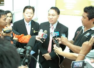 Pattaya Chief Justice Apichart Thepnoo (center) addresses the press after handing down a ruling of 2.3 million baht compensation for each death to the families of two Chinese tourists killed in last month's speedboat accident off Bali Hai Pier, a little less than a third of what they asked for.
