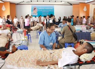 Military personnel and their families donate blood in honor of HM the Queen's 81st birthday.