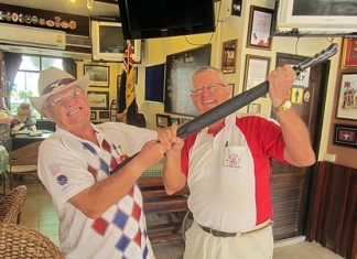 Dick Warberg (right) graciously hands over the MBMG Group golfer of the month prize to Derek Brook.
