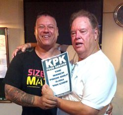 The boss presents the KPK voucher to Mike Johns.