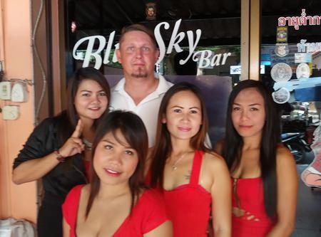 Beaker Larsen celebrates his win with the staff at Blue Sky Bar.