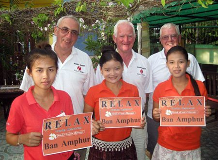 Tuesday's winners pose with staff at The Relax Bar.