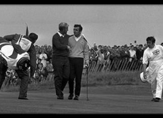 Jack Nicklaus and Tony Jacklin shake hands as the walk off the 18th green during the 1969 Ryder Cup at Royal Birkdale, northwest England.