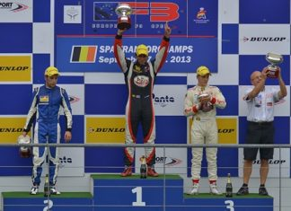 Sandy Stuvik (center) celebrates victory on the podium after victory in race 1 at the Spa Francorchamps racetrack in Belgium, Saturday, Sept. 7.