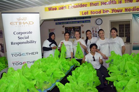 Etihad staff and volunteers donated more than 200 bags of groceries to the families of Philippine Community Fund students in the Smokey Mountain area in Tondo Manila.
