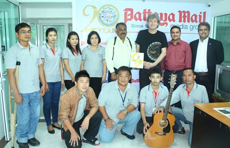 Hucky Eichelmann (standing 3rd right) poses for a photo with Pattaya Mail Media Group management and staff during his courtesy call to the office on Monday, Sept. 16.