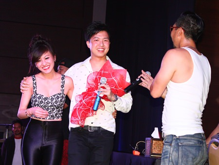 Joey Boy (right) applauds the Thai-Korean couple on stage following a successful marriage proposal.