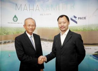 Sorapoj Techakraisri (right), CEO of PACE Development Corporation Plc, is pictured with Sompong Chintawongvanich President of Thai Obayashi Corp. Ltd., during a contract signing ceremony to award the structural work of the MahaSamutr development.