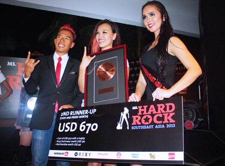 Tan Chin Fern (center) flashed the Hard Rock symbol after winning 2nd runner-up.