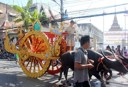 Elaborately ordained carts are eye-catchers in the opening festivities parade.