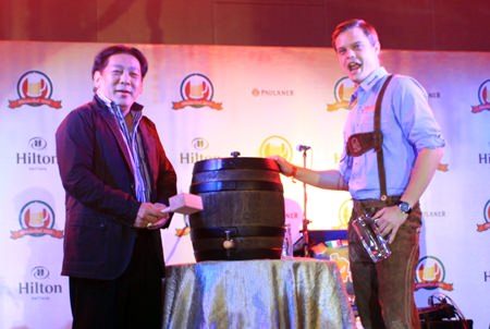 """Loud cheers of """"O'zapft is!"""" filled the beer hall as Chanyuth Hengtrakul, Secretary to the Minister of Education taps the first beer keg."""
