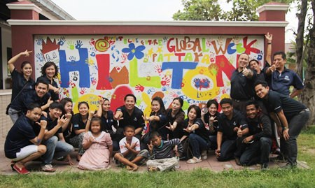 During the afternoon the Hilton Pattaya staff and the children shared some fun, decorating the wall opposite the commemoration plaques with bright colored paint and children's handprints.