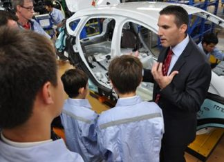 Todd Barber of Ford Motor Company provides Regent's students with a detailed tour of the assembly plant.