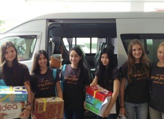 St. Andrews students arrive with boxes of goodies for the children.