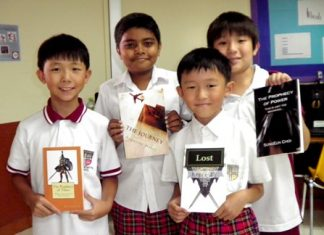 Year 4 and Year 6 students stand proudly with their published novels (2012).
