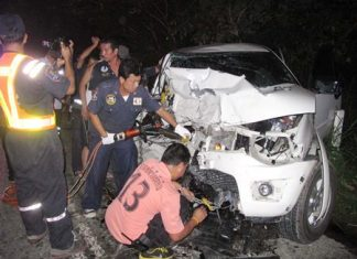 Rescue officials use Jaws of Life to extract one of the victims from the wreck.