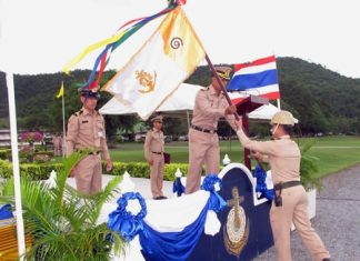 Chief of Staff Capt. Ekachai Sukwanno presents an honor flag to one of the outstanding instructors of the new recruits.