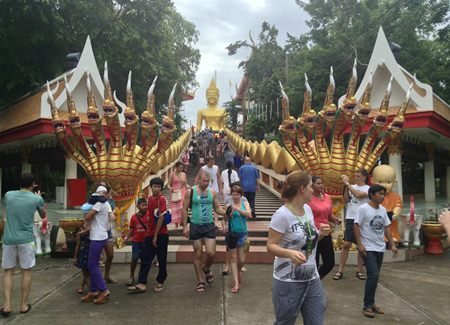 Citizens and Thai and foreign tourists pay their respects to Lord Buddha and make merit at Wat Khao Phra Yai on Pratamnak Hill.
