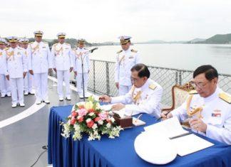 Vice Adm. Phijan Theeranet and Adm. Khanat Thongphun sign the necessary documents aboard the HTMS Kraburi, turning over command of the Royal Thai Fleet to Vice Adm. Phijan Theeranet.