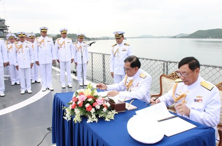 Vice Adm. Phijan Theeranet and Adm. Khanat Thongphun sign the necessary documents aboard the HTMS Kraburi, turning over command of the Royal Thai Fleet to Vice Adm. Phijan Theeranet.