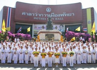 Novice monks line up outside City Hall at last year's dedication to HM the King.