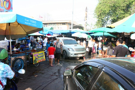 Vendors have set up their wares on the sidewalks leading to the parking lot in the Lan Po Market area.