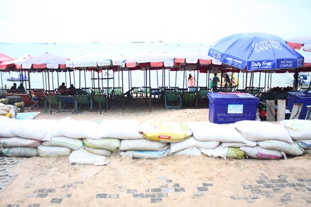 Beach bench operators have lined the beach side of the promenade with sandbags in an attempt to keep their businesses from washing away.