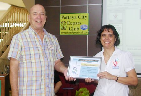 Board member Roy Albiston presents Margie with a Certificate of Appreciation for her thought provoking presentation. More information about the 'Hand To Hand' organisation and its work can be found at http://www.handtohandpattaya.com.