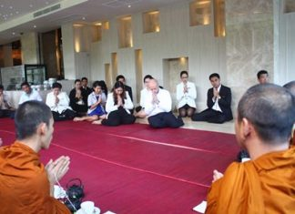 Dominique Ronge (center) GM of the Centara Grand Pratamnak Resort Pattaya, along with Chananchida Wongsa-ard (center, left), Sales and PR manager of the Centara Grand Resort and Spa and other staff take part in the blessing ceremony of the Centara Grand Phratamnak Resort Pattaya.