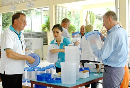 Rotarians and friends assemble the water filters in preparation to donate them to the school.
